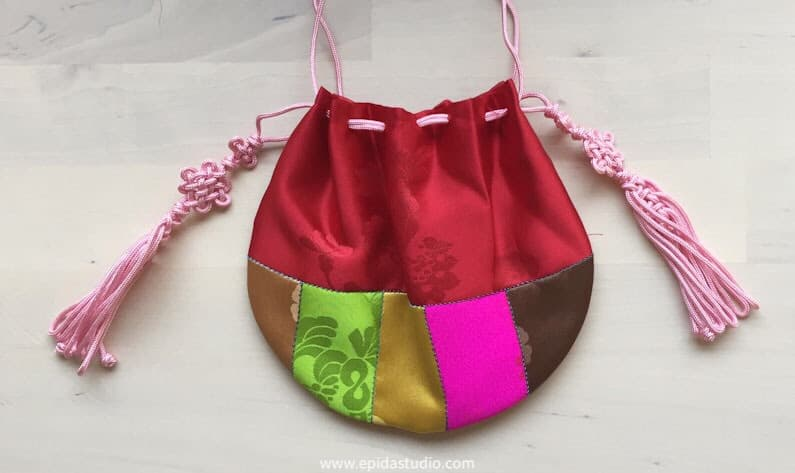 round Korean lucky bag made with bright coloured silk.