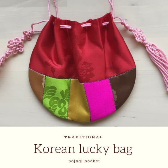 "hand stitched red silk purse with title ""Korean lucky bag""."