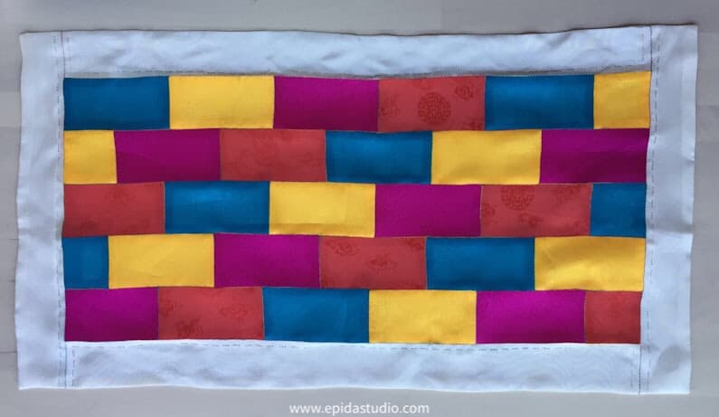 patchwork mat made with bright colours of silk.