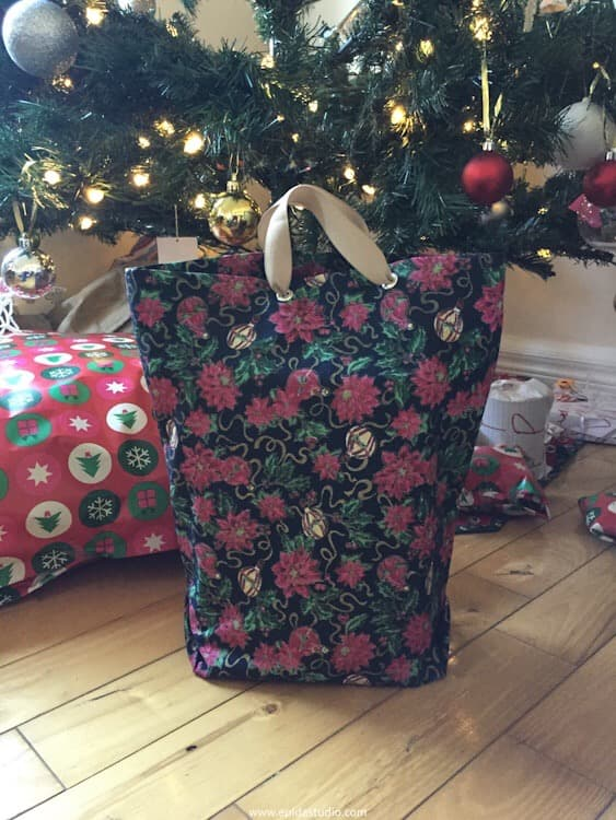 gift bag under a Christmas tree.