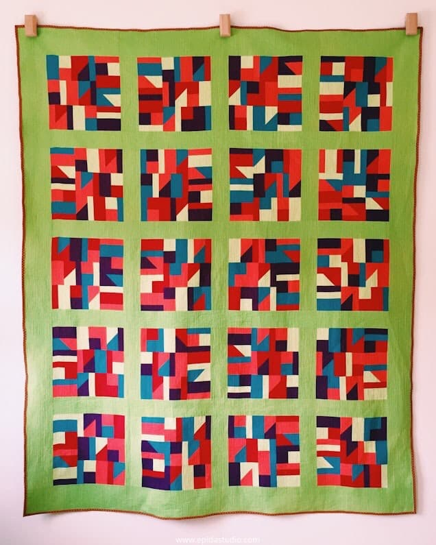 Pojagi Inspirations quilt in primary colours with green sashing,