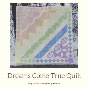 "colourful sampler quilt with title ""Dreams Come True Quilt""."