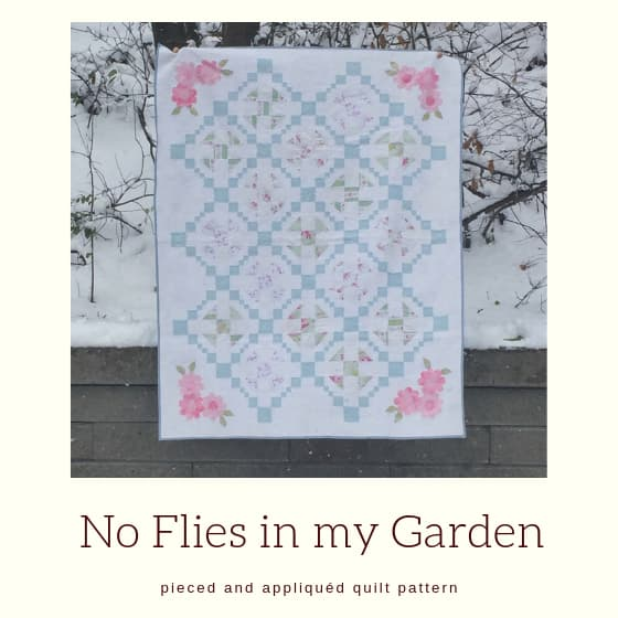 "quilt picture with title ""No Flies in my Garden""."