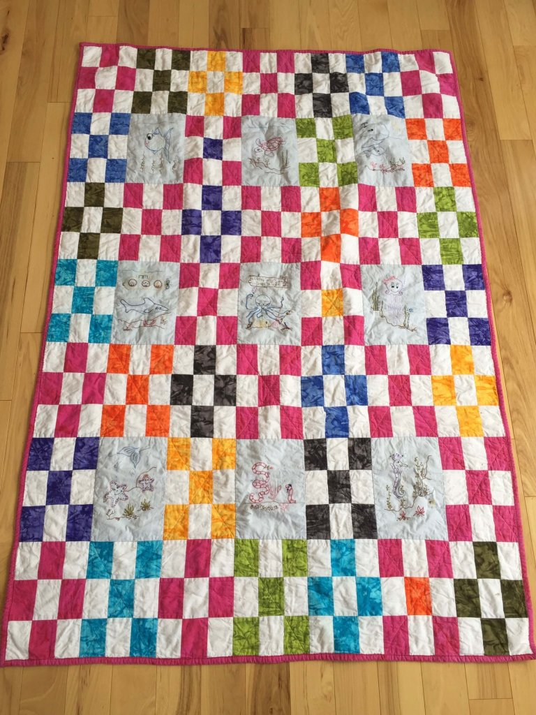 nine patch quilt in bright colours
