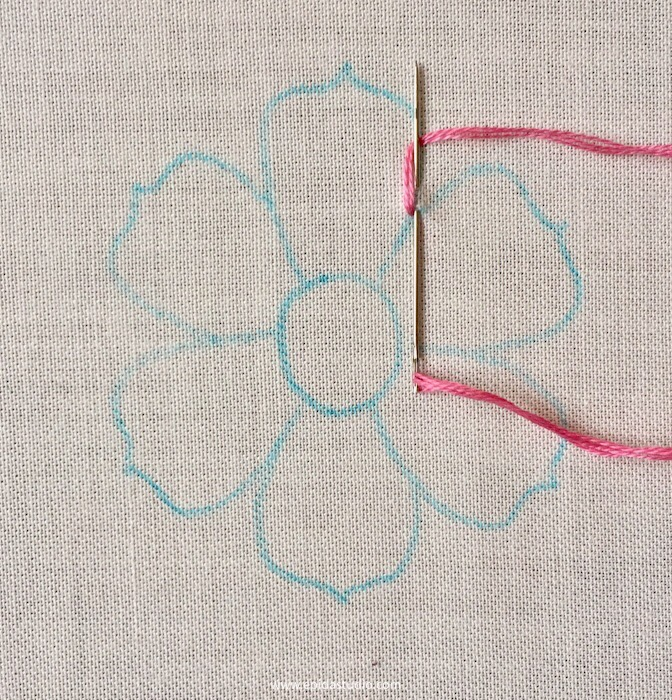 embroidery on white fabric with pink thread