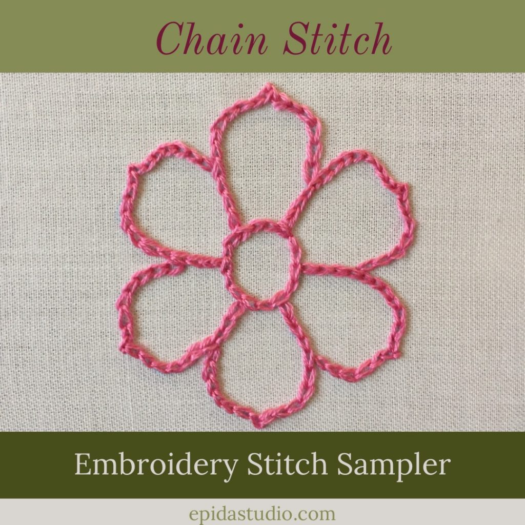 chain stitch embroidery tutorial with pink flower embroidered on white fabric