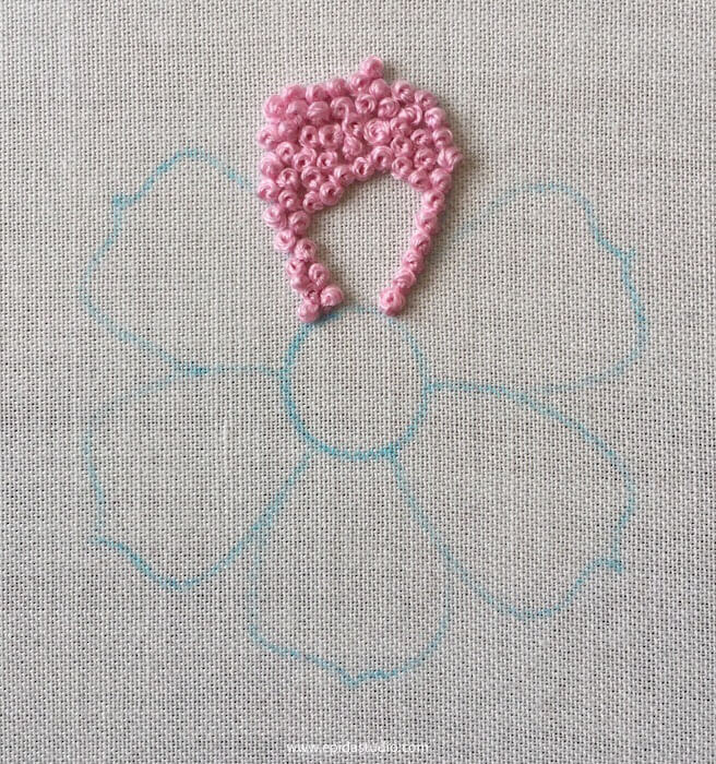 pink embroidery of a flower