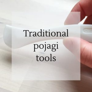 "hand holding a hera with title ""traditional pojagi tools""."