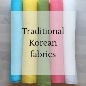 "rolls of coloured ramie with text overlay ""traditional Korean fabrics""."