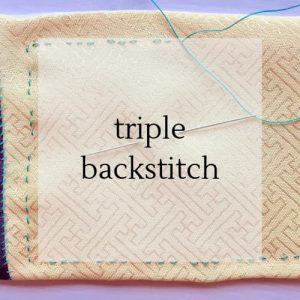 "stitching on yellow silk fabric with title ""triple backstitch""."